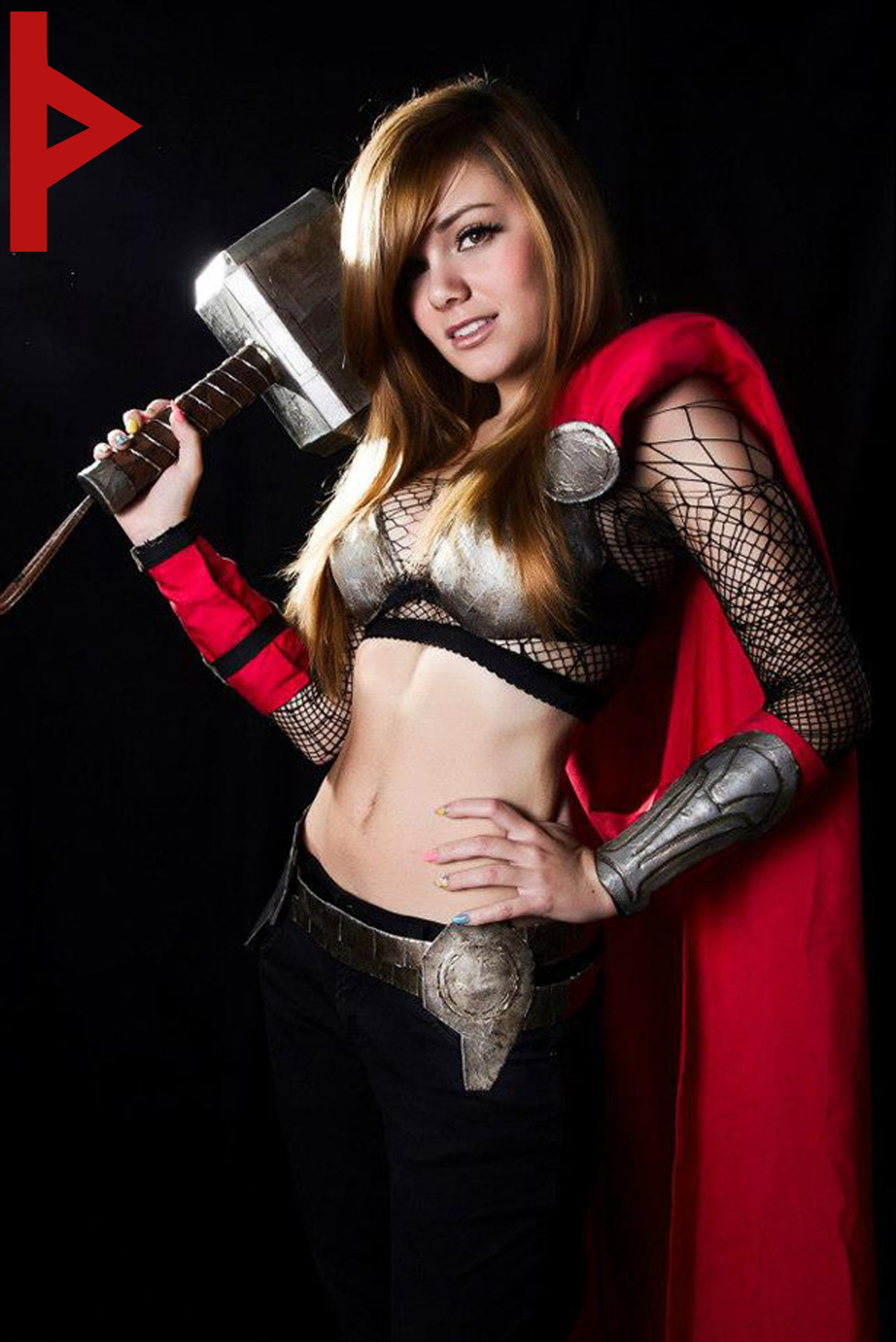 More on Adult Thor Costume: The god of Thunder has a sexy side when she's wearing a Thor Costume for women. This Thor Costume features a printed sleeveless jumpsuit with a silver metallic panel on the top and solid black on the bottom.